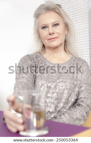 An image of a best age woman with a cup of tea - stock photo