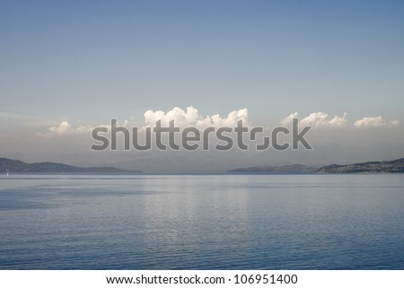 An image of a big cloud over the sea