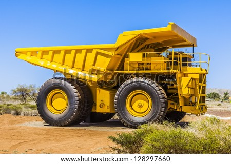An image of a big yellow transporter - stock photo