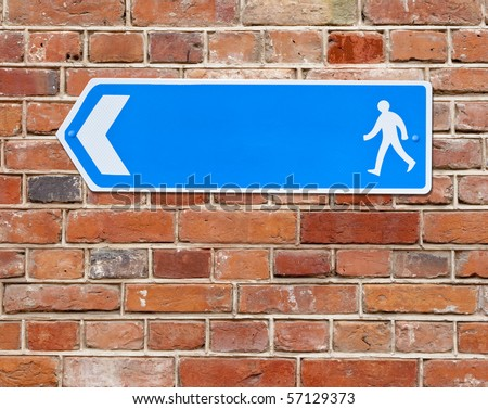 An image of a blue arrow road sign - stock photo