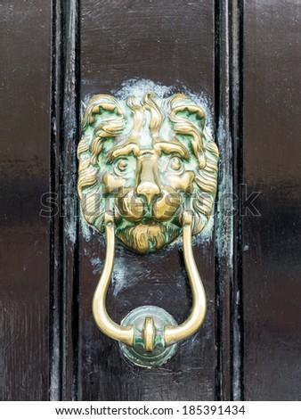 An image of a brass door knocker - stock photo