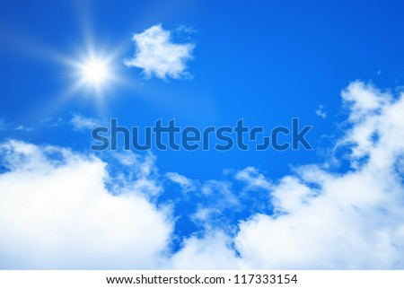 An image of a bright blue sky sun background - stock photo