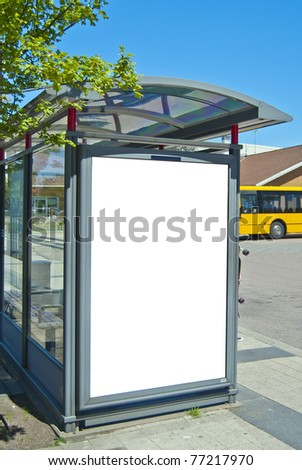 An image of a bus stop with a blank bilboard for your advertising situated in the swedish city of Bastad.