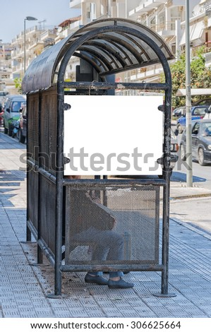 An image of a bus stop with a blank bilboard for your advertising situated on the Greek island of Crete. - stock photo