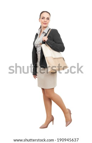 An image of a business woman with a beige handbag