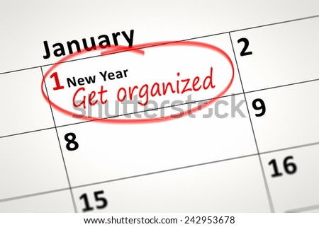 An image of a calendar detail shows first of January with the text get organized - stock photo