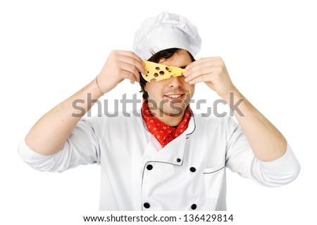 An image of a chef  looking through the cheese hole - stock photo
