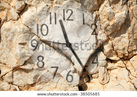 an image of a clock on rock background - stock photo