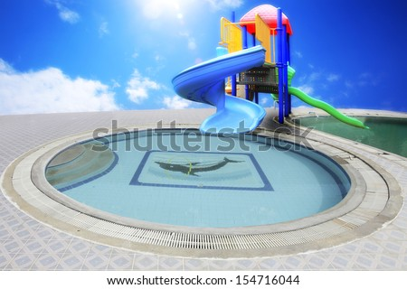 An image of a colorful children playground,  sliders, aqua park, water park without children. - stock photo
