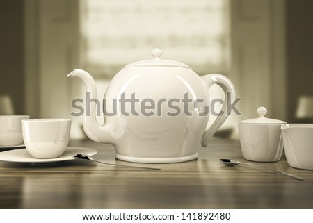 An image of a cream colored teapot and teacups