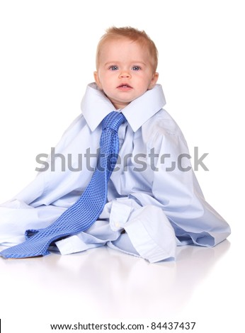 An image of a cute baby in a suit, wearing over sized clothes.  Images is isolated on white with reflection.