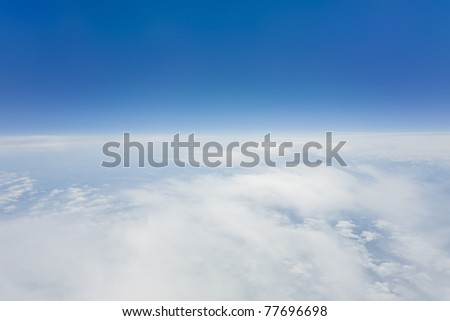 An image of a flight over the clouds - stock photo