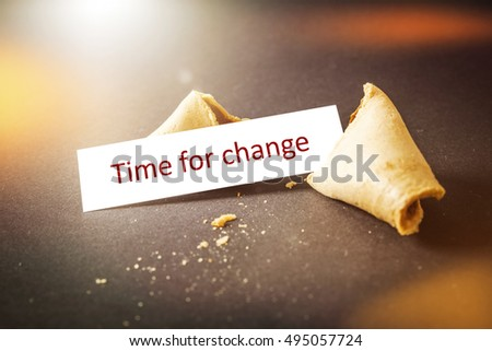 An image of a fortune cookie with message time for change