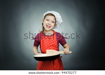An image of a funny girl in white hat with frying pan - stock photo