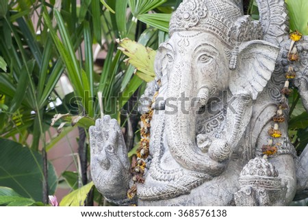 An image of a ganesha sculpture in the garden - stock photo
