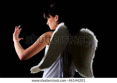 An image of a girl dressed like an angel