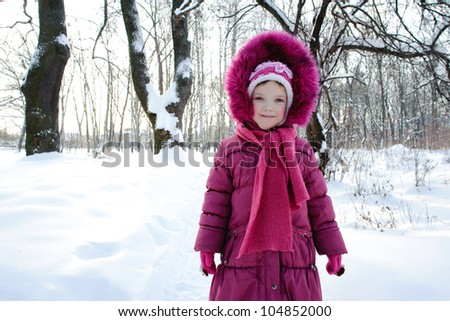 An image of a girl in a park in winter - stock photo