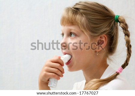An image of a girl making inhalation