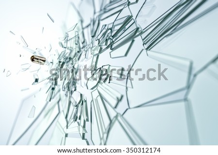 An image of a glass damaged by a bullet - stock photo