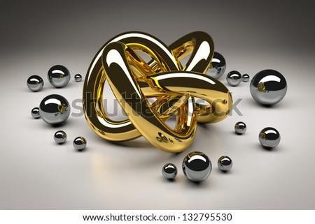 An image of a golden torus with chrome balls - stock photo