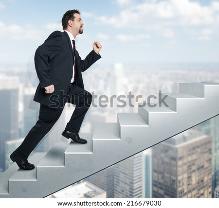 An image of a handsome business man moving upwards