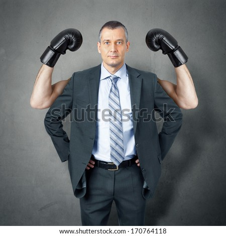 An image of a handsome business man protected by boxer  - stock photo