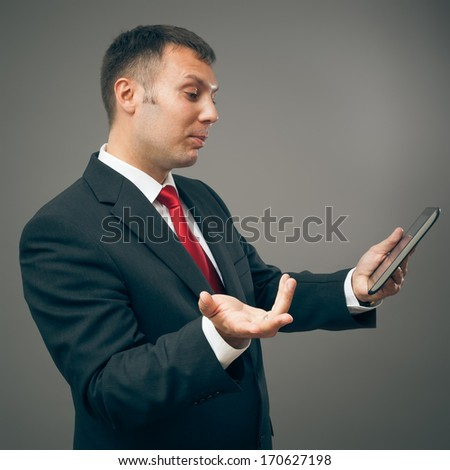 An image of a handsome business man with a tablet pc - stock photo