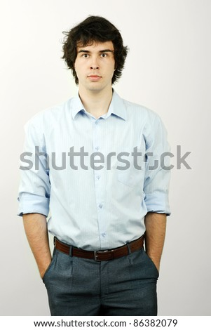 An image of a handsome man in a blue shirt