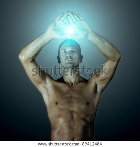 An image of a handsome man showing a triangle with his hands - stock photo