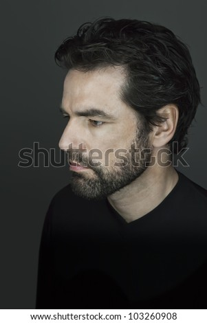 An image of a handsome man with a beard - stock photo