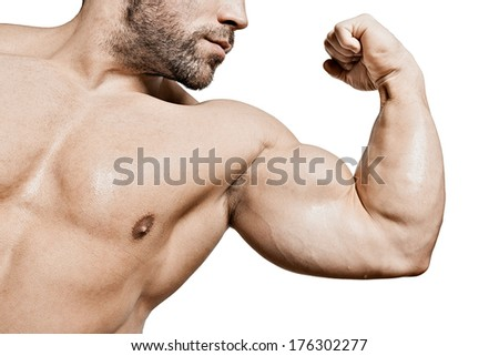 An image of a handsome young muscular sports man flexing his bicep