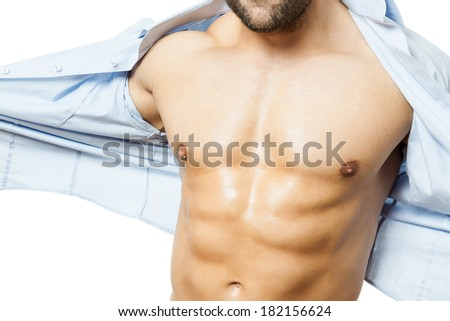 An image of a handsome young muscular sports man shirt off - stock photo