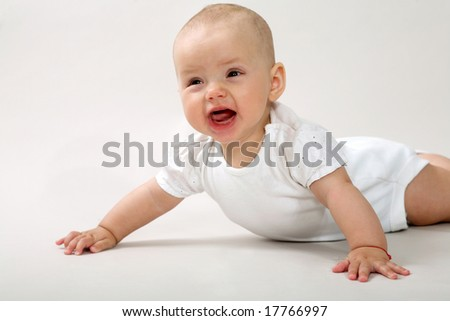 An image of a little baby crowning in studio