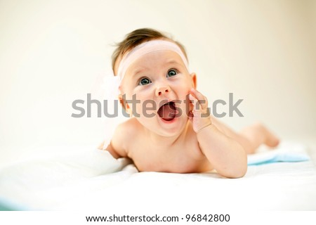 An image of a little baby-girl with her mouth open - stock photo
