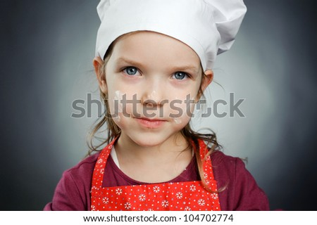 An image of a lovely little chef - stock photo