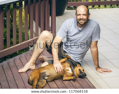 An image of a man and his dog - stock photo