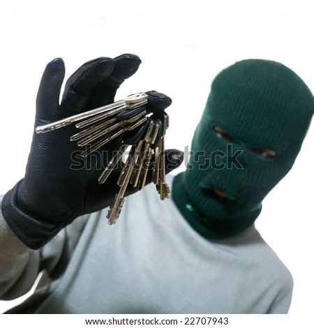 An image of a man in mask with a bunch of keys