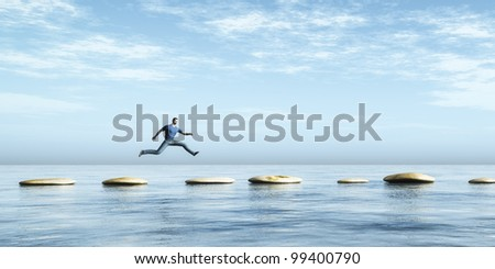 An image of a man jumping from stone to stone - stock photo