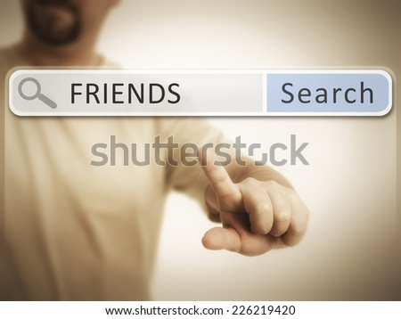 An image of a man who is searching the web after friends - stock photo