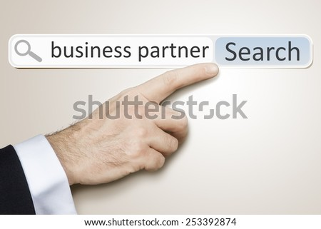 An image of a man who is searching the web for business partner - stock photo
