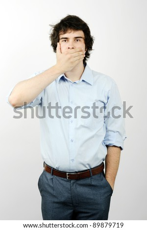 An image of a man with his hand on his mouth - stock photo