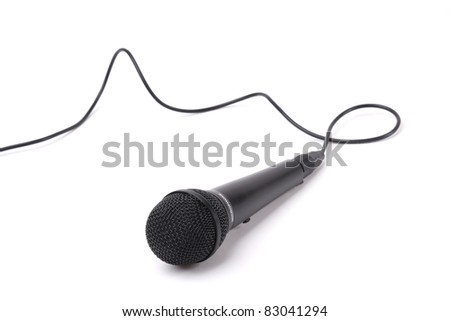 An image of a microphone with cable isolated on white background