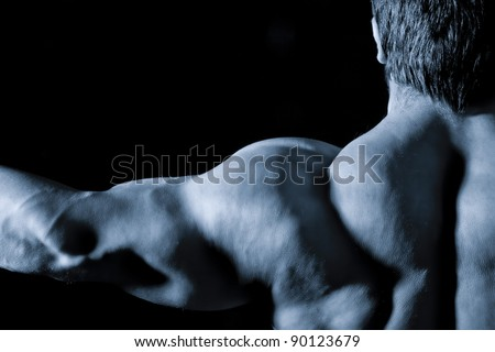 An image of a muscular sports man back