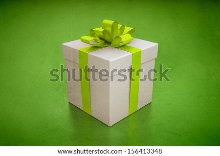 An image of a nice gift box on a green background - stock photo