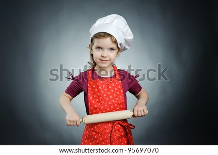 An image of a nice girl in a white hat with a rolling-pin - stock photo