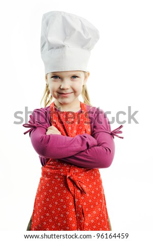 An image of a nice girl in white hat and red apron - stock photo