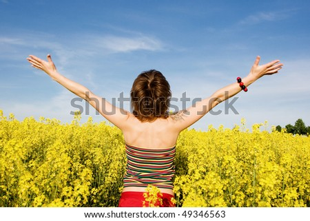 An image of a nice girl standing in the field