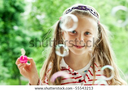 An image of a nice girl with bubbles