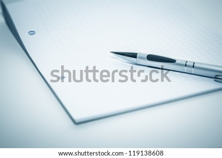 An image of a notepad and a ball-pen - stock photo