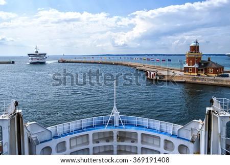 An image of a passenger ferry commuting between Helsingborg in Sweden and Helsingor in Denmark - stock photo